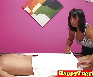 Busty asian masseuse with tanlines jerks cock