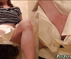 Asian pees and rubs pussy