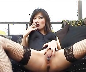 Russian Prostitute Lyuba B smoking and her pierced cunt