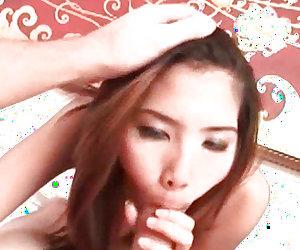Gorgeous asian babe doing oral sex